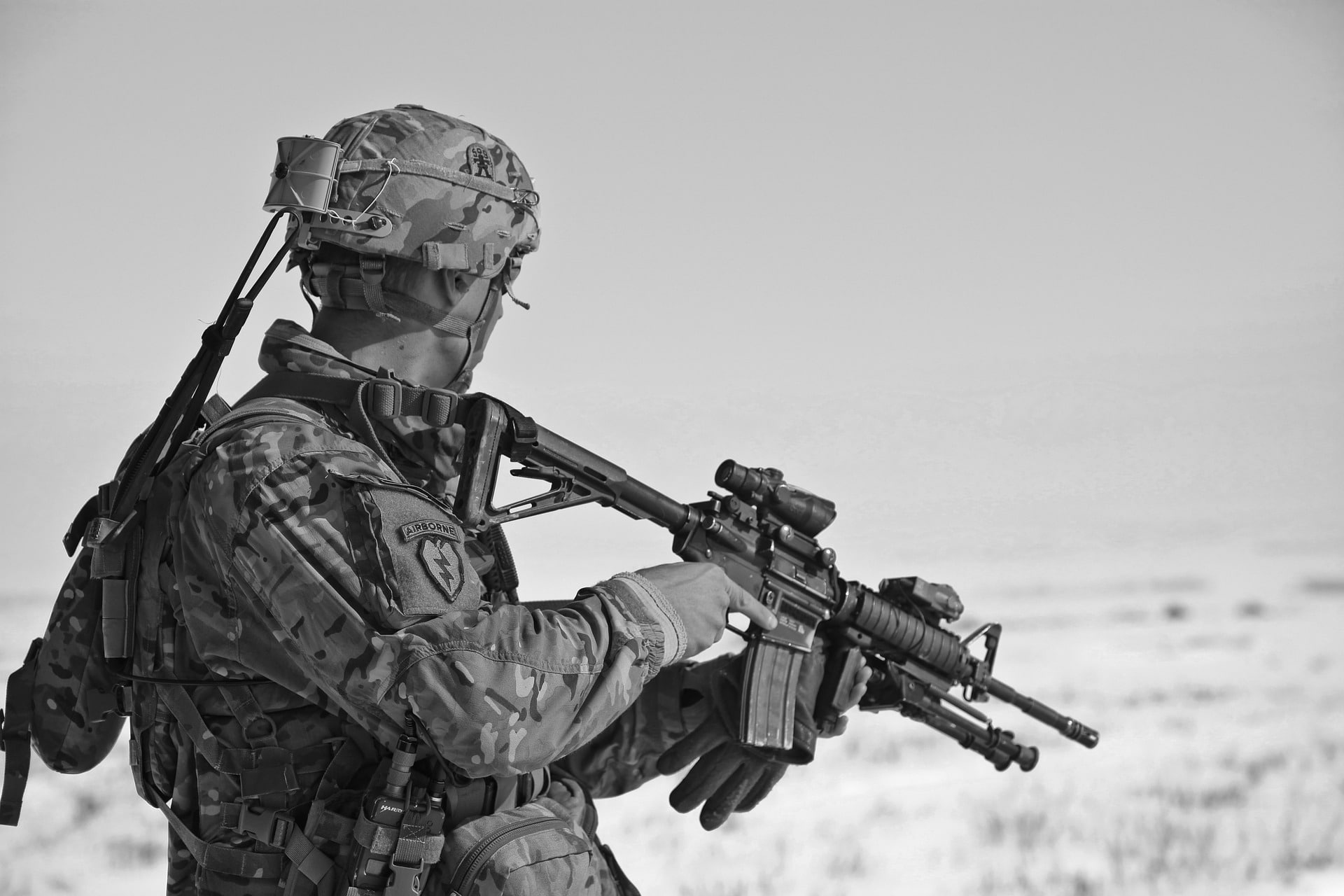 black and white soldier with an assault rifle