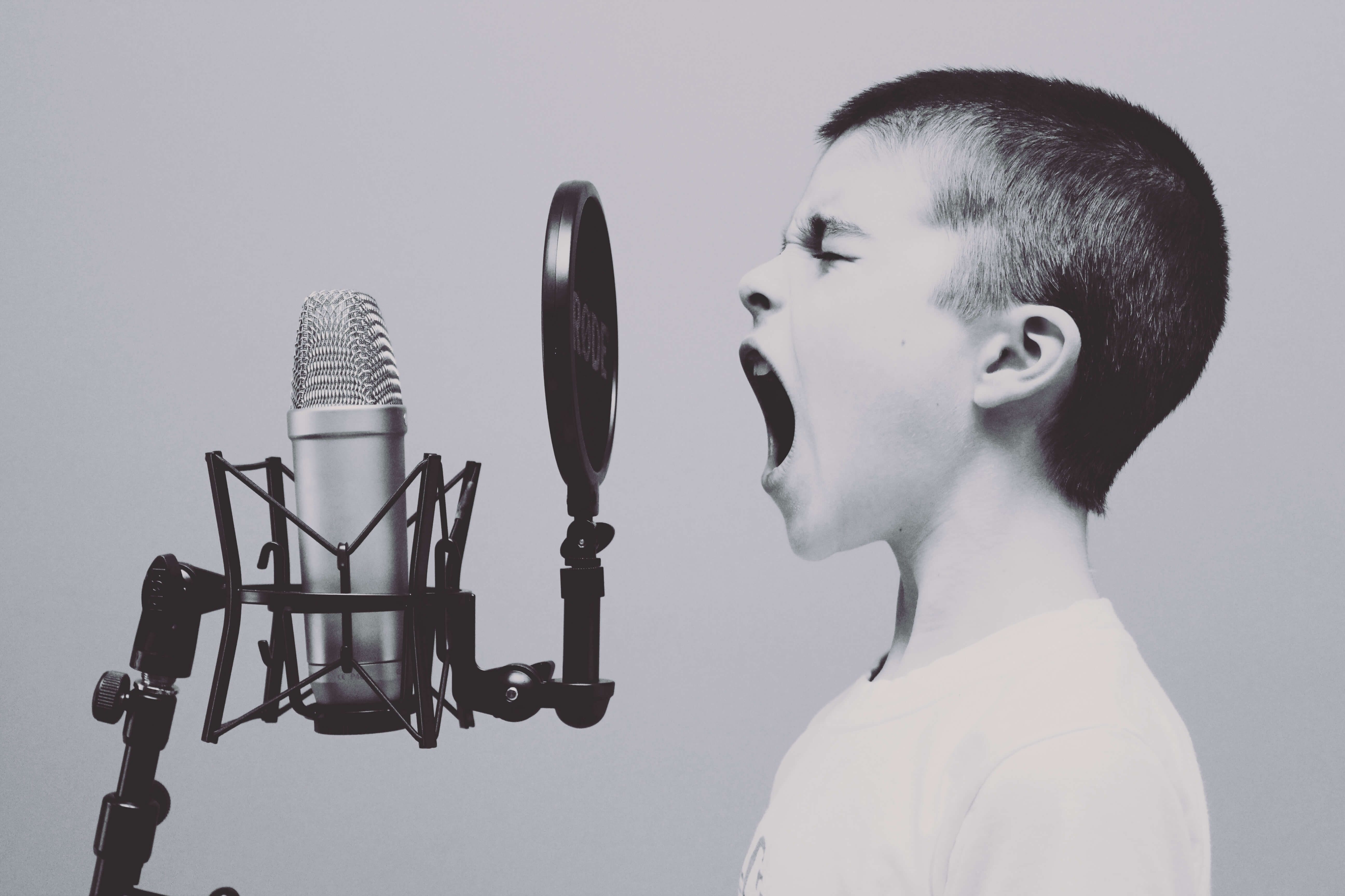 boy shouting to a microphone