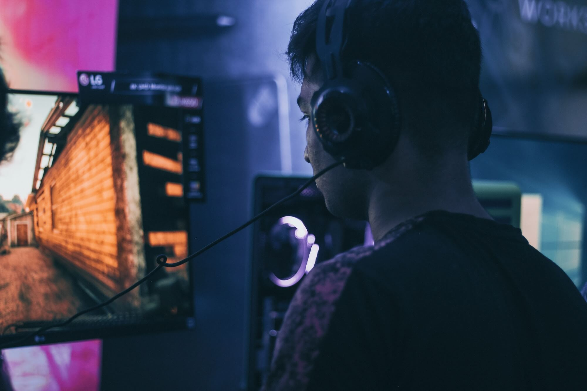 man in a headset playing games